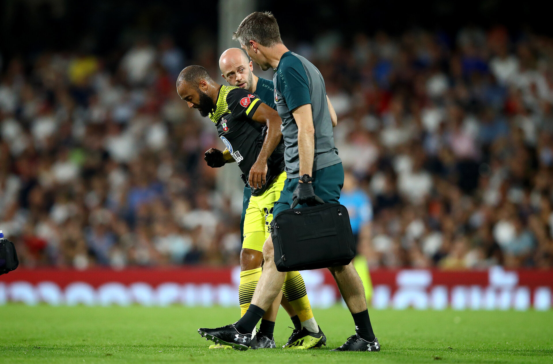 LONDON, ENGLAND - AUGUST 27: Nathan Redmond of Southampton picks up an injury during the Carabao Cup second round match between Fulham and Southampton FC at Craven Cottage on August 27, 2019 in London, England. (Photo by Matt Watson/Southampton FC via Getty Images)