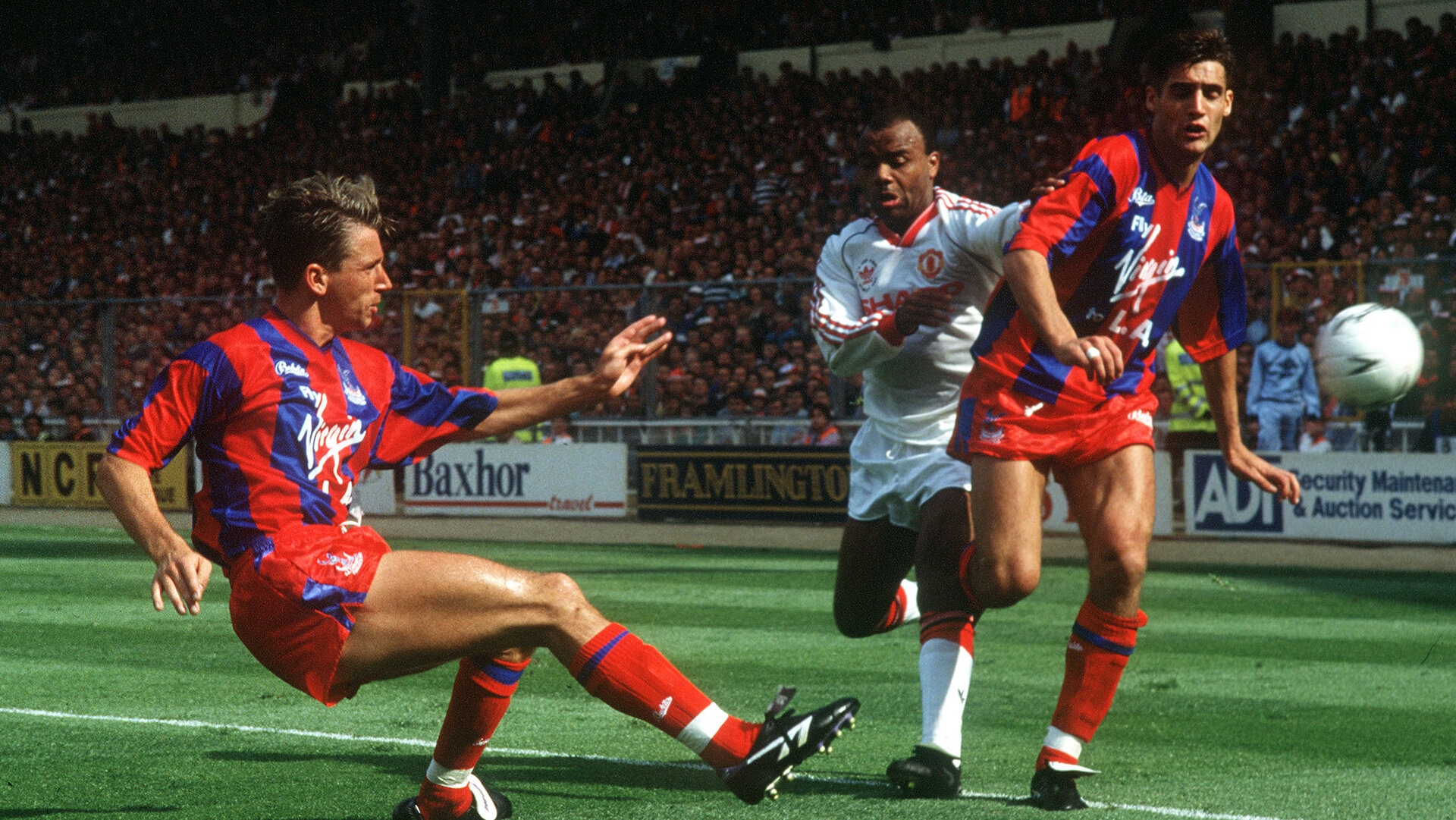 Football - Crystal Palace v Manchester United - FA Cup  Final - 12/5/90  Mandatory Credit : Action Images  Alan Pardew clears for Crystal Palace as Danny Wallace moves in