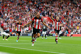 Ten-man Saints battle to United draw