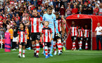 SOUTHAMPTON, ENGLAND - AUGUST 31: Pierre-Emile Hojbjerg leads the teams out with the match day mascots during the Premier League match between Southampton FC and Manchester United at St Mary's Stadium on August 31, 2019 in Southampton, United Kingdom. (Photo by Matt Watson/Southampton FC via Getty Images)
