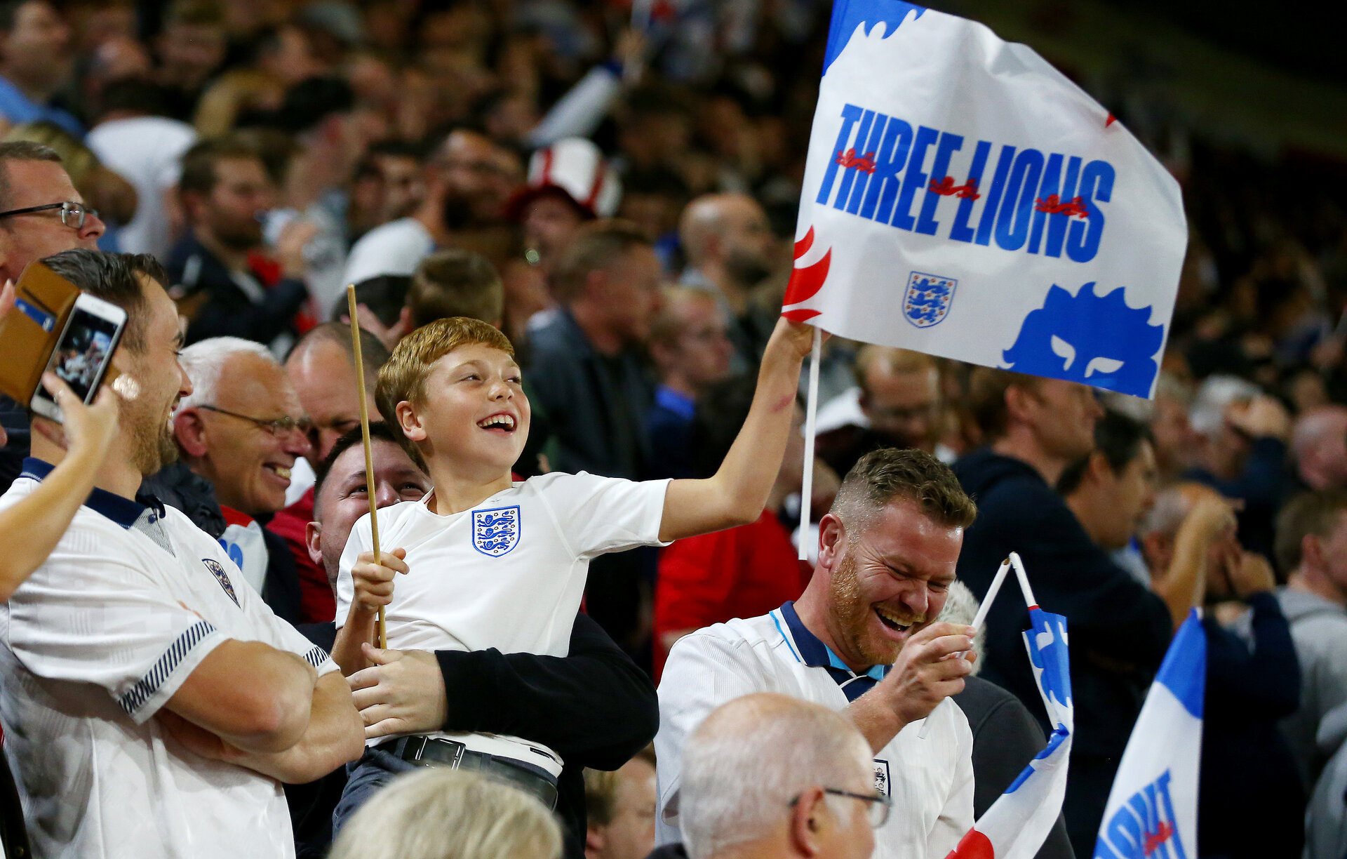 SOUTHAMPTON, ENGLAND - SEPTEMBER 10: A young England fan celebrates during the UEFA Euro 2020 qualifier match between England and Kosovo at St. Mary's Stadium on September 10, 2019 in Southampton, England. (Photo by Matt Watson/Southampton FC via Getty Images)
