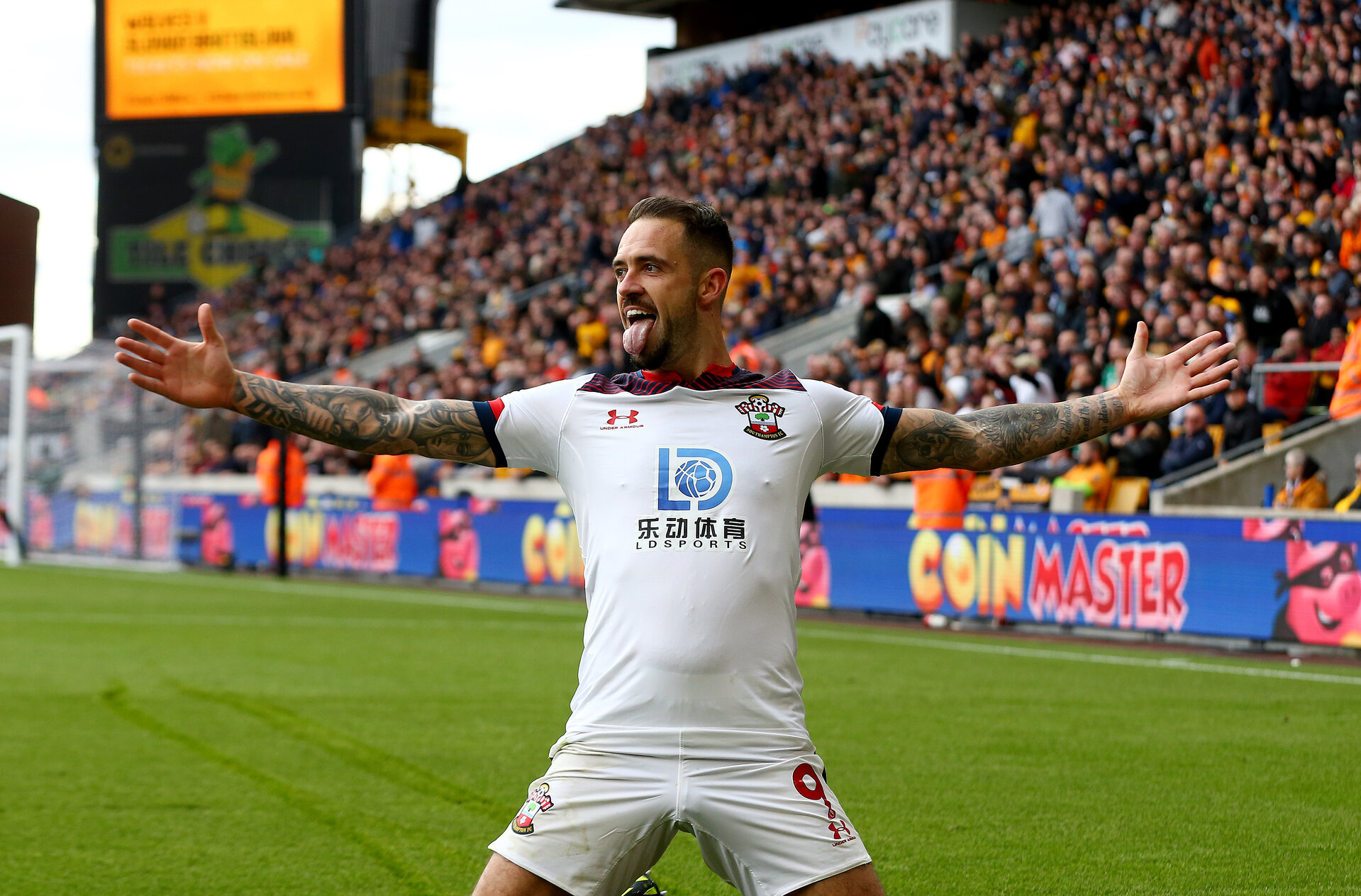 WOLVERHAMPTON, ENGLAND - OCTOBER 19: Danny Ings of Southampton celebrates after putting his side 1-0 up during the Premier League match between Wolverhampton Wanderers and Southampton FC at Molineux on October 19, 2019 in Wolverhampton, United Kingdom. (Photo by Matt Watson/Southampton FC via Getty Images)