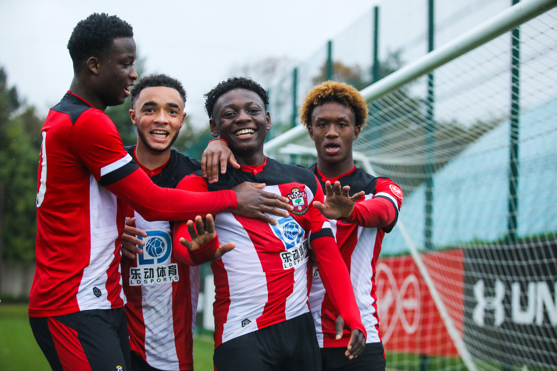 SOUTHAMPTON, ENGLAND - OCTOBER 26: Kazeem Olaigbe of Southampton FC (Centre-Right) celebrates scoring Southampton's first goal with Rio Glean (R), Jayden Smith (Centre-Left), and Roland Idowu (L) of Southampton FC during the Under 18s Premier League Cup match between Southampton FC and Swansea City at the Staplewood Campus on October 26, 2019 in Southampton, England