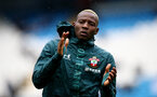 MANCHESTER, ENGLAND - NOVEMBER 02: Moussa Djenepo of Southampton warms up during the Premier League match between Manchester City and Southampton FC at Etihad Stadium on November 02, 2019 in Manchester, United Kingdom. (Photo by Matt Watson/Southampton FC via Getty Images)