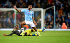 MANCHESTER, ENGLAND - NOVEMBER 02: Moussa Djenepo(L) of Southampton fouls Raheem Sterling of Manchester City during the Premier League match between Manchester City and Southampton FC at Etihad Stadium on November 02, 2019 in Manchester, United Kingdom. (Photo by Matt Watson/Southampton FC via Getty Images)