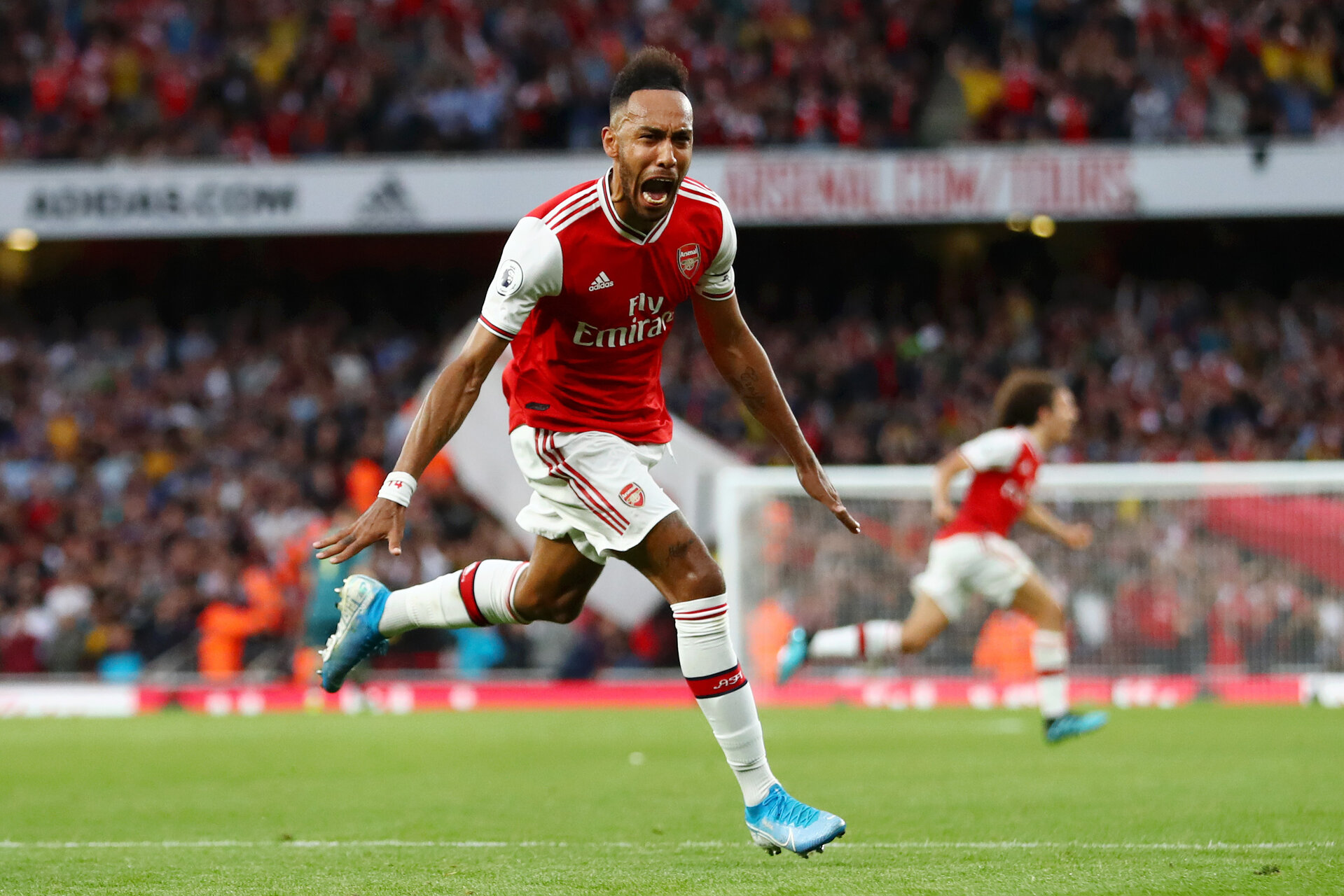 LONDON, ENGLAND - SEPTEMBER 22: Pierre-Emerick Aubameyang of Arsenal celebrates scoring his team's third goal during the Premier League match between Arsenal FC and Aston Villa at Emirates Stadium on September 22, 2019 in London, United Kingdom. (Photo by Michael Steele/Getty Images)