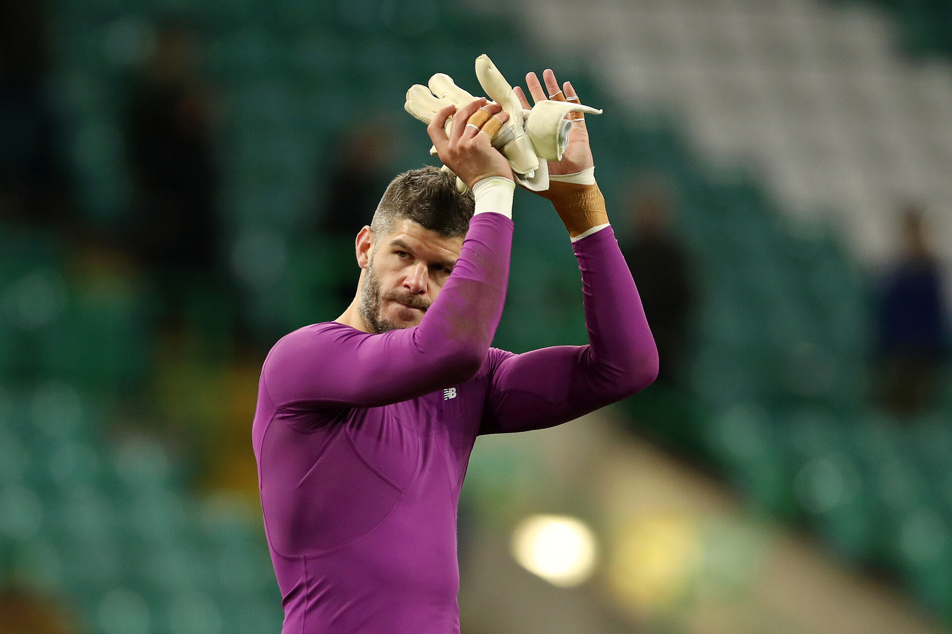 GLASGOW, SCOTLAND - NOVEMBER 28: Fraser Forster of Celtic shows his appreciation to the fans after the UEFA Europa League group E match between Celtic FC and Stade Rennes at Celtic Park on November 28, 2019 in Glasgow, United Kingdom. (Photo by Ian MacNicol/Getty Images)