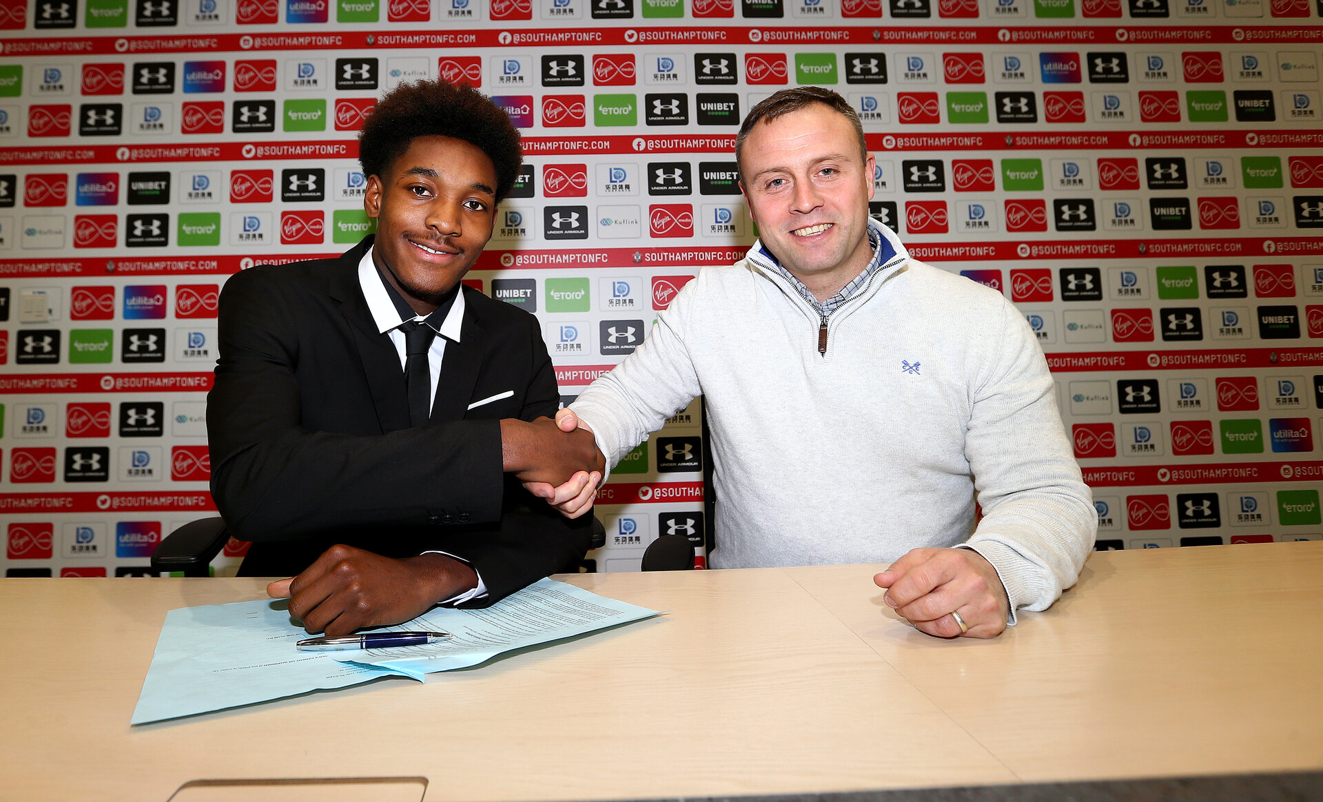SOUTHAMPTON, ENGLAND - DECEMBER 02: Ramello Mitchell signs his first professional contract with Southampton FC, pictured with Academy Director Matt Hale, at the Staplewood Campus on December 02, 2019 in Southampton, England. (Photo by Matt Watson/Southampton FC via Getty Images)