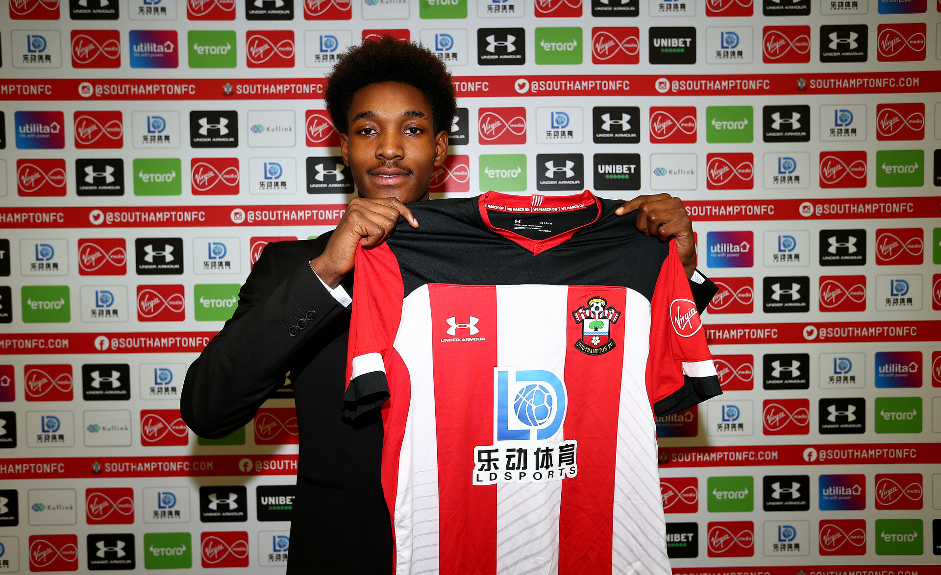 SOUTHAMPTON, ENGLAND - DECEMBER 02: Ramello Mitchell signs his first professional contract with Southampton FC, at the Staplewood Campus on December 02, 2019 in Southampton, England. (Photo by Matt Watson/Southampton FC via Getty Images)