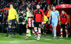 SOUTHAMPTON, ENGLAND - DECEMBER 04: Pierre-Emile Hojbjerg leads the teams out with the match day mascot during the Premier League match between Southampton FC and Norwich City at St Mary's Stadium on December 04, 2019 in Southampton, United Kingdom. (Photo by Matt Watson/Southampton FC via Getty Images)