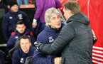 SOUTHAMPTON, ENGLAND - DECEMBER 14: Manuel Pellegrini  and Ralph Hasenhüttl during the Premier League match between Southampton FC and West Ham United at St Mary's Stadium on December 14, 2019 in Southampton, United Kingdom. (Photo by Chris Moorhouse/Southampton FC via Getty Images)