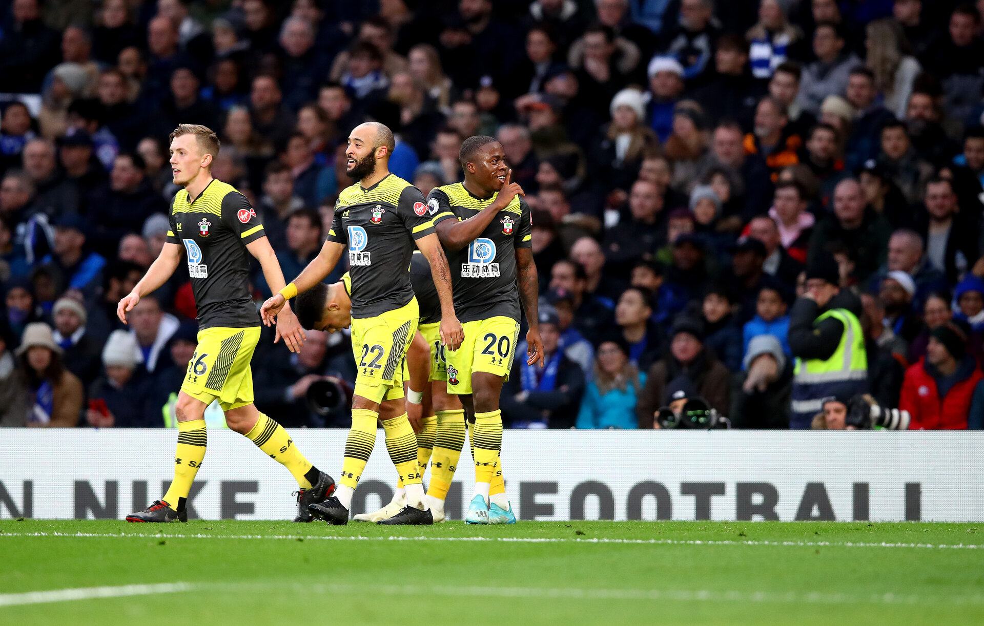 LONDON, ENGLAND - DECEMBER 26: Michael Obafemi(20) of Southampton celebrates with his team mates after opening the scoring during the Premier League match between Chelsea FC and Southampton FC at Stamford Bridge on December 26, 2019 in London, United Kingdom. (Photo by Matt Watson/Getty Images)