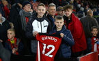 SOUTHAMPTON, ENGLAND - DECEMBER 28: fans who were given Moussa Djenepo shirt during the Premier League match between Southampton FC and Crystal Palace at St Mary's Stadium, on December 28, 2019 in Southampton, United Kingdom. (Photo by Isabelle Field/Getty Images)