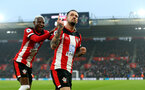 SOUTHAMPTON, ENGLAND - JANUARY 01: Danny Ings(R) of Southampton celebrates with Moussa Djenepo(L) after scoring during the Premier League match between Southampton FC and Tottenham Hotspur at St Mary's Stadium on January 01, 2020 in Southampton, United Kingdom. (Photo by Matt Watson/Southampton FC via Getty Images)
