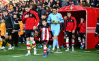 SOUTHAMPTON, ENGLAND - JANUARY 18: Pierre-Emile Hojbjerg of Southampton leads the teams out with the match day mascot during the Premier League match between Southampton FC and Wolverhampton Wanderers at St Mary's Stadium on January 18, 2020 in Southampton, United Kingdom. (Photo by Matt Watson/Southampton FC via Getty Images)