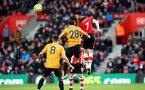 SOUTHAMPTON, ENGLAND - JANUARY 18: Shane Long(R) of Southampton wins the ball in the air during the Premier League match between Southampton FC and Wolverhampton Wanderers at St Mary's Stadium on January 18, 2020 in Southampton, United Kingdom. (Photo by Matt Watson/Southampton FC via Getty Images)