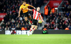SOUTHAMPTON, ENGLAND - JANUARY 18: Adama Traore(L) of Wolverhampton Wanderers and Pierre-Emile Hojbjerg of Southampton during the Premier League match between Southampton FC and Wolverhampton Wanderers at St Mary's Stadium on January 18, 2020 in Southampton, United Kingdom. (Photo by Matt Watson/Southampton FC via Getty Images)