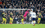 LONDON, ENGLAND - FEBRUARY 05: Angus Gunn of punches clear during the FA Cup Fourth Round Replay match between Tottenham Hotspur and Southampton FC at Tottenham Hotspur Stadium on February 05, 2020 in London, England. (Photo by Matt Watson/SouthamptonFC via Getty Images)