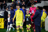 Lead the team out at Norwich City