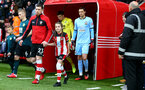 SOUTHAMPTON, ENGLAND - FEBRUARY 15: Pierre-Emile Højbjerg of Southampton leads the teams out with the match day mascot during the Premier League match between Southampton FC and Burnley FC at St Mary's Stadium on February 15, 2020 in Southampton, United Kingdom. (Photo by Matt Watson/Southampton FC via Getty Images)