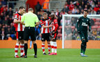 SOUTHAMPTON, ENGLAND - MARCH 07: Moussa Djenepo(R) of Southampton is consoled by James Ward-Prowse(L) after being shown a red card during the Premier League match between Southampton FC and Newcastle United at St Mary's Stadium on March 07, 2020 in Southampton, United Kingdom. (Photo by Matt Watson/Southampton FC via Getty Images)