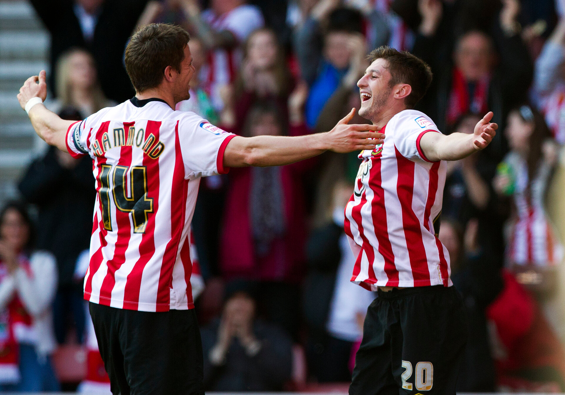 SOUTHAMPTON, ENGLAND - MARCH 10: Adam Lallana of Southampton (R) celebrates with Dean Hammond of Southampton (L) after scoring his team's second goal of the game during the npower Championship match between Southampton and Barnsley at St. Mary's Stadium on March 10, 2012 in Southampton, England.  (Photo by Ben Hoskins/Getty Images)