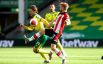 NORWICH, ENGLAND - JUNE 19: (L) Tom Trybull and (R) Stuart Armstrong uring the Premier League match between Norwich City and Southampton FC at Carrow Road on June 19, 2020 in Norwich, United Kingdom. (Photo by Matt Watson/Southampton FC via Getty Images)