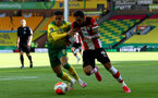 NORWICH, ENGLAND - JUNE 19: (L) Max Aarons and Danny Ings (R) during the Premier League match between Norwich City and Southampton FC at Carrow Road on June 19, 2020 in Norwich, United Kingdom. (Photo by Matt Watson/Southampton FC via Getty Images)