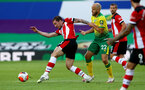 NORWICH, ENGLAND - JUNE 19: (L) Pierre-Emile Hojbjerg and (R) Teemu Pukki during the Premier League match between Norwich City and Southampton FC at Carrow Road on June 19, 2020 in Norwich, United Kingdom. (Photo by Matt Watson/Southampton FC via Getty Images)
