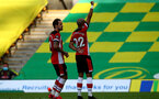 NORWICH, ENGLAND - JUNE 19: (L) Danny Ings and (R) Nathan Redmond goal celebration during the Premier League match between Norwich City and Southampton FC at Carrow Road on June 19, 2020 in Norwich, United Kingdom. (Photo by Matt Watson/Southampton FC via Getty Images)
