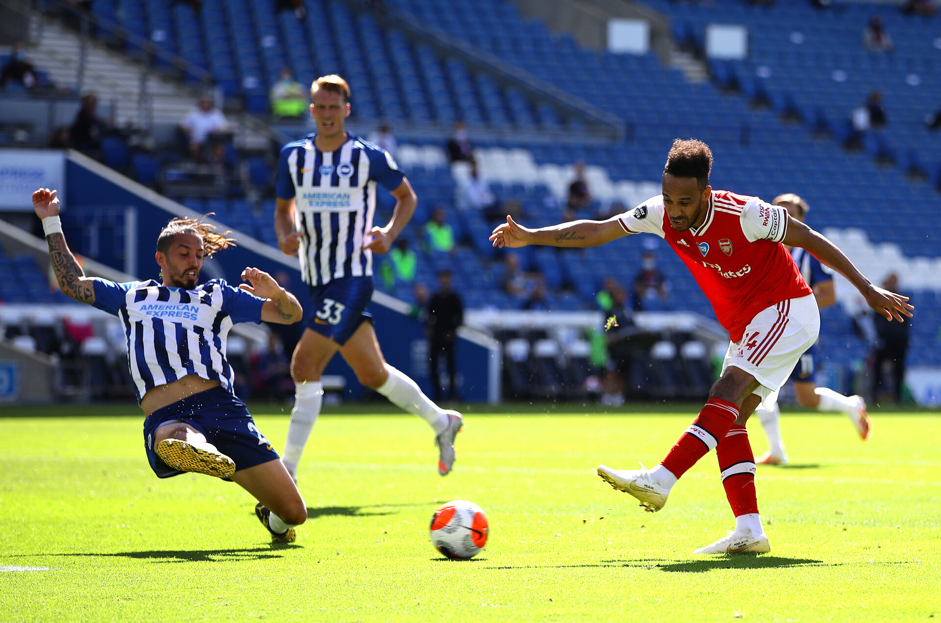 BRIGHTON, ENGLAND - JUNE 20: Pierre-Emerick Aubameyang of Arsenal shoots during the Premier League match between Brighton & Hove Albion and Arsenal FC at American Express Community Stadium on June 20, 2020 in Brighton, England. Football Stadiums around Europe remain empty due to the Coronavirus Pandemic as Government social distancing laws prohibit fans inside venues resulting in all fixtures being played behind closed doors. (Photo by Richard Heathcote/Getty Images)