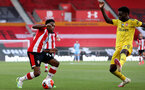 SOUTHAMPTON, ENGLAND - JUNE 25: (L) Kyle Walkers-Peters and Bukayo Saka during the Premier League match between Southampton FC and Arsenal FC at St Mary's Stadium on March 21, 2020 in Southampton, United Kingdom. (Photo by Chris Moorhouse/Southampton FC via Getty Images)