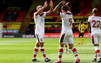 WATFORD, ENGLAND - JUNE 28: (L) Oriol Romeu and Danny Ings (L) celebrating Danny Ings goal during the Premier League match between Watford FC and Southampton FC at Vicarage Road on April 4, 2020 in Watford, United Kingdom. (Photo by Matt Watson/Southampton FC via Getty Images)