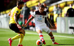 WATFORD, ENGLAND - JUNE 28: (L) Kilo Femenia and (R) Danny Ings during the Premier League match between Watford FC and Southampton FC at Vicarage Road on April 4, 2020 in Watford, United Kingdom. (Photo by Matt Watson/Southampton FC via Getty Images)