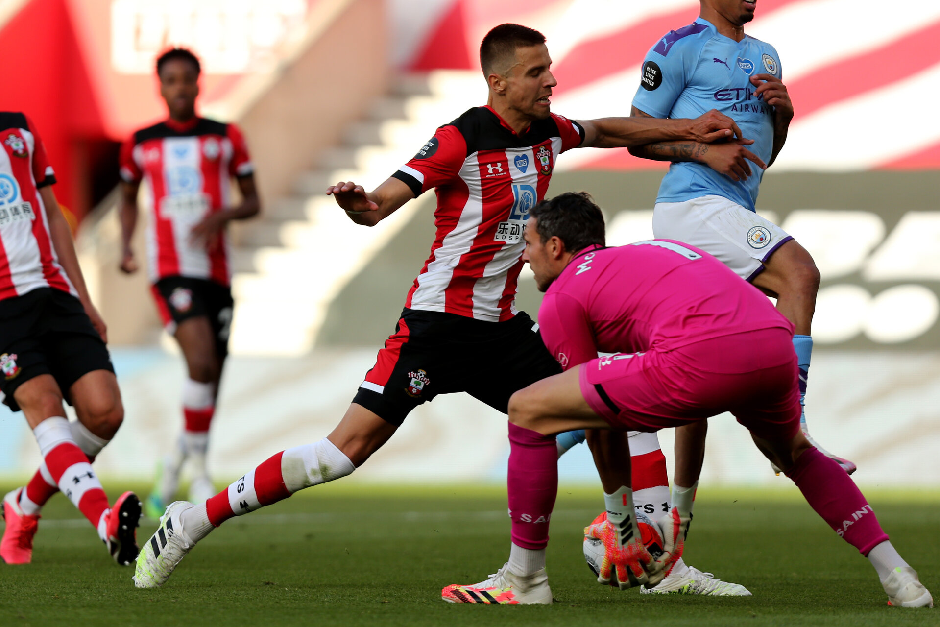 SOUTHAMPTON, ENGLAND - JULY 05: Jan Bednarek (L) and Alex McCarthy (R) during the Premier League match between Southampton FC and Manchester City at St Mary's Stadium on July 5, 2020 in Southampton, United Kingdom. Football Stadiums around Europe remain empty due to the Coronavirus Pandemic as Government social distancing laws prohibit fans inside venues resulting in games being played behind closed doors. (Photo by Chris Moorhouse /Southampton FC via Getty Images)