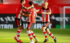 SOUTHAMPTON, ENGLAND - JULY 05: Danny Ings (L) Ché Adams and James Ward-Prowse (R) clebrating Ché Adams goal during the Premier League match between Southampton FC and Manchester City at St Mary's Stadium on July 5, 2020 in Southampton, United Kingdom. Football Stadiums around Europe remain empty due to the Coronavirus Pandemic as Government social distancing laws prohibit fans inside venues resulting in games being played behind closed doors. (Photo by Matt Watson/Southampton FC via Getty Images)