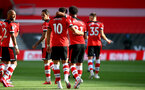 SOUTHAMPTON, ENGLAND - JULY 05:  Ché Adams (L) and Ryan Bertrand (R) clebrating Ché Adams goal during the Premier League match between Southampton FC and Manchester City at St Mary's Stadium on July 5, 2020 in Southampton, United Kingdom. Football Stadiums around Europe remain empty due to the Coronavirus Pandemic as Government social distancing laws prohibit fans inside venues resulting in games being played behind closed doors. (Photo by Matt Watson/Southampton FC via Getty Images)