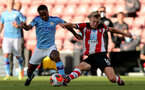 SOUTHAMPTON, ENGLAND - JULY 05: Raheem Sterling (L) and James Ward-Prowse (R)  during the Premier League match between Southampton FC and Manchester City at St Mary's Stadium on July 5, 2020 in Southampton, United Kingdom. Football Stadiums around Europe remain empty due to the Coronavirus Pandemic as Government social distancing laws prohibit fans inside venues resulting in games being played behind closed doors. (Photo by Chris Moorhouse /Southampton FC via Getty Images)