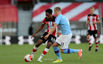 SOUTHAMPTON, ENGLAND - JULY 05:  Kyle Walker-Peters (L) and Oleksandr Zinchenko (R) during the Premier League match between Southampton FC and Manchester City at St Mary's Stadium on July 5, 2020 in Southampton, United Kingdom. Football Stadiums around Europe remain empty due to the Coronavirus Pandemic as Government social distancing laws prohibit fans inside venues resulting in games being played behind closed doors. (Photo by Chris Moorhouse/Southampton FC via Getty Images)