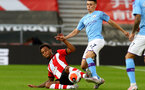 SOUTHAMPTON, ENGLAND - JULY 05: Ryan Bertrand (L) and Phil Foden during the Premier League match between Southampton FC and Manchester City at St Mary's Stadium on July 5, 2020 in Southampton, United Kingdom. Football Stadiums around Europe remain empty due to the Coronavirus Pandemic as Government social distancing laws prohibit fans inside venues resulting in games being played behind closed doors. (Photo by Matt Watson/Southampton FC via Getty Images)