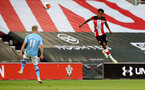 SOUTHAMPTON, ENGLAND - JULY 05:  Oleksandr Zinchenko (L) and Kyle Walker-Peters (R) during the Premier League match between Southampton FC and Manchester City at St Mary's Stadium on July 5, 2020 in Southampton, United Kingdom. Football Stadiums around Europe remain empty due to the Coronavirus Pandemic as Government social distancing laws prohibit fans inside venues resulting in games being played behind closed doors. (Photo by Matt Watson/Southampton FC via Getty Images)