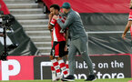 SOUTHAMPTON, ENGLAND - JULY 05: Ryan Bertrand (L) and Ralph Hasenhuttl(R) during the Premier League match between Southampton FC and Manchester City at St Mary's Stadium on July 5, 2020 in Southampton, United Kingdom. Football Stadiums around Europe remain empty due to the Coronavirus Pandemic as Government social distancing laws prohibit fans inside venues resulting in games being played behind closed doors. (Photo by Chris Moorhouse/Southampton FC via Getty Images)