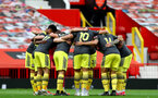 MANCHESTER, ENGLAND - JULY 13:  southampton huddle ahead of the Premier League match between Manchester United and Southampton FC at Old Trafford on July 13, 2020 in Manchester, United Kingdom. Football Stadiums around Europe remain empty due to the Coronavirus Pandemic as Government social distancing laws prohibit fans inside venues resulting in all fixtures being played behind closed doors. (Photo by Matt Watson/Southampton FC via Getty Images)