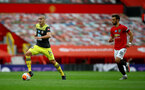 MANCHESTER, ENGLAND - JULY 13: Oriol Romeu(L) of Southampton during the Premier League match between Manchester United and Southampton FC at Old Trafford on July 13, 2020 in Manchester, United Kingdom. Football Stadiums around Europe remain empty due to the Coronavirus Pandemic as Government social distancing laws prohibit fans inside venues resulting in all fixtures being played behind closed doors. (Photo by Matt Watson/Southampton FC via Getty Images)