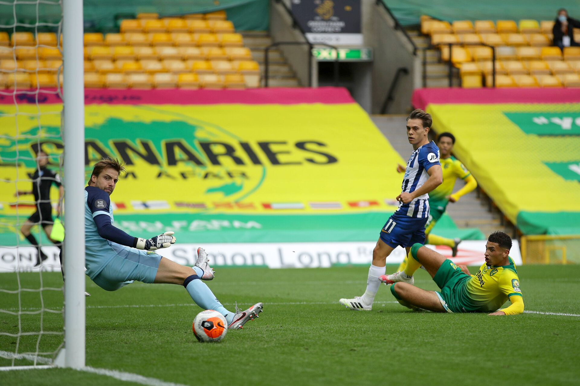 NORWICH, ENGLAND - JULY 04: Leondro Trossard of Brighton and Hove Albion scores his team's first goal past Tim Krul of Norwich City during the Premier League match between Norwich City and Brighton & Hove Albion at Carrow Road on July 04, 2020 in Norwich, England. Football Stadiums around Europe remain empty due to the Coronavirus Pandemic as Government social distancing laws prohibit fans inside venues resulting in all fixtures being played behind closed doors. (Photo by Richard Heathcote/Getty Images)
