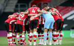 SOUTHAMPTON, ENGLAND - JULY 16: team huddle ahead of the Premier League match between Southampton FC and Brighton & Hove Albion at St Mary's Stadium on July 16, 2020 in Southampton, United Kingdom. Football Stadiums around Europe remain empty due to the Coronavirus Pandemic as Government social distancing laws prohibit fans inside venues resulting in all fixtures being played behind closed doors. (Photo by Chris Moorhouse/Southampton FC via Getty Images)