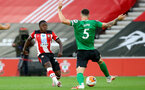 SOUTHAMPTON, ENGLAND - JULY 16: Michael Obafemi (L) of southampton and Lewis Dunk (R) of brighton during the Premier League match between Southampton FC and Brighton & Hove Albion at St Mary's Stadium on July 16, 2020 in Southampton, United Kingdom. Football Stadiums around Europe remain empty due to the Coronavirus Pandemic as Government social distancing laws prohibit fans inside venues resulting in all fixtures being played behind closed doors. (Photo by Matt Watson/Southampton FC via Getty Images)