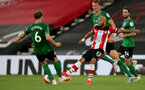 SOUTHAMPTON, ENGLAND - JULY 16: Dale Stephens (L) of brighton and Nathan Redmond (R) of southampton during the Premier League match between Southampton FC and Brighton & Hove Albion at St Mary's Stadium on July 16, 2020 in Southampton, United Kingdom. Football Stadiums around Europe remain empty due to the Coronavirus Pandemic as Government social distancing laws prohibit fans inside venues resulting in all fixtures being played behind closed doors. (Photo by Chris Moorhouse/Southampton FC via Getty Images)