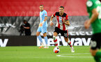 SOUTHAMPTON, ENGLAND - JULY 16: Jan Bednarek of Southampton during the Premier League match between Southampton FC and Brighton & Hove Albion at St Mary's Stadium on July 16, 2020 in Southampton, United Kingdom. Football Stadiums around Europe remain empty due to the Coronavirus Pandemic as Government social distancing laws prohibit fans inside venues resulting in all fixtures being played behind closed doors. (Photo by Matt Watson/Southampton FC via Getty Images)