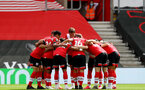 SOUTHAMPTON, ENGLAND - JULY 26: Southampton huddle ahead of the Premier League match between Southampton FC and Sheffield United at St Mary's Stadium on April 17, 2020 in Southampton, United Kingdom. (Photo by Matt Watson/Southampton FC via Getty Images)